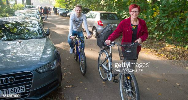 Anja Stoeck top candidate of Germany's left wing Die Linke party for regional elections in Lower Saxony pushes her bike as she arrives at a polling...