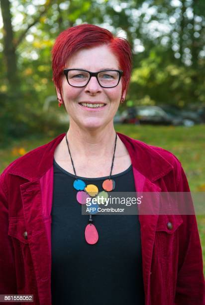 Anja Stoeck top candidate of Germany's left wing Die Linke party for regional elections in Lower Saxony smiles as she arrives at a polling station in...