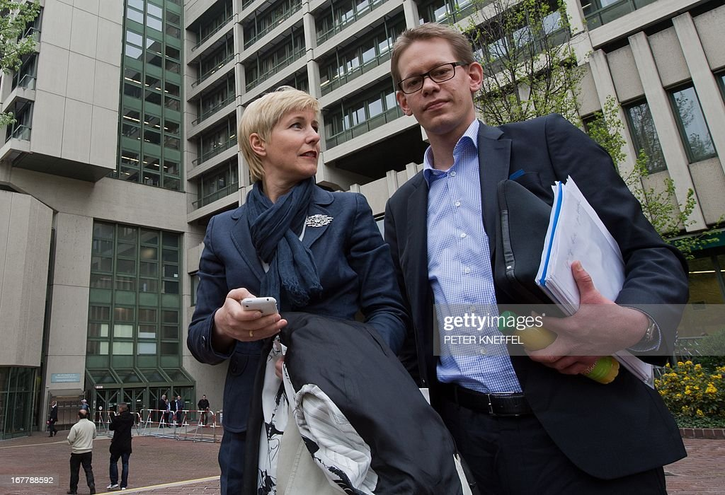 Anja Sturm (L) and Wolfgang Heer (R), lawyers of the sole survivor of the far-right militants NSU Beate Zschaepe (not in pic) poses in front of the Higher Regional Court Munich (Oberlandesgerichtes Muenchen) on April 29, 2013 in Munich, southern Germany. The trial against Zschaepe and four other alleged neo-Nazi accomplices, begins on May 6, 2013.