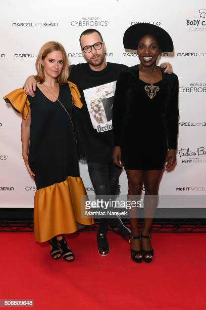 Anja Tillack Marcell Von Berlin and Nikeata Thompson during the Marcell Von Berlin 'Genesis' collection presentation on July 3 2017 in Berlin Germany