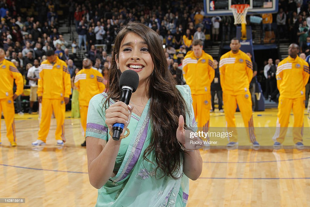 Anjali Ranadive, daughter of Warriors Vice Chairman Vivek Ranadive, preforms the national anthem during a game between the Dallas Mavericks and the Golden State Warriors on April 12, 2012 at Oracle Arena in Oakland, California.