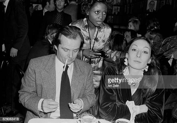 Anjelica Huston seated with Jack Nicholson at Sardis circa 1960 New York