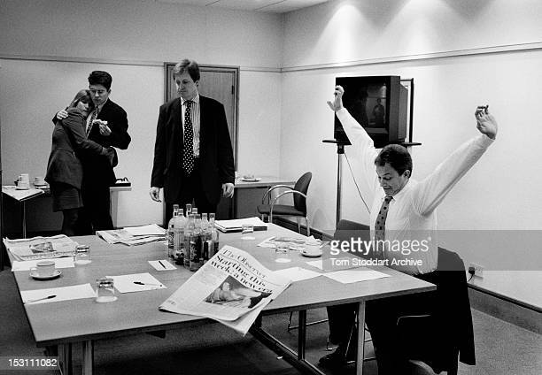 Anji Hunter shares a sandwich and a hug with David Miliband as Alistair Campbell and Tony Blair prepare for the last week of the general election...