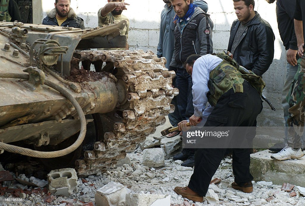 Anjir Anjir, a Syrian rebel who drives a tank, adjust the treads on a captured T-72 in Kfar Nbouda, Syria, February 27, 2013. Syrian rebels are increasingly using tanks and armored personnel carriers in the fighting against the Syrian government.