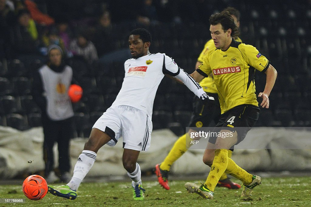 Anji's Samuel Eto'o (L) vies for the ball with Young Boys' Alain Nef (R) during the Europa League group A football match between BSC Young Boys and FC Anji Makhachkala on Decenber 6, 2012, in Bern.