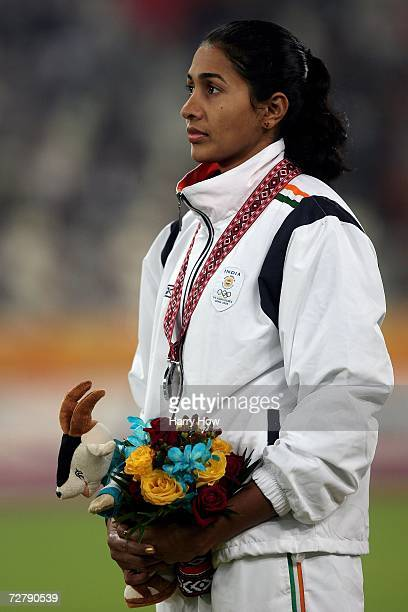Anju Bobby George of India celebrates silver in the Women's Long Jump Medal Ceremony during the 15th Asian Games Doha 2006 at the Khalifa Stadium...
