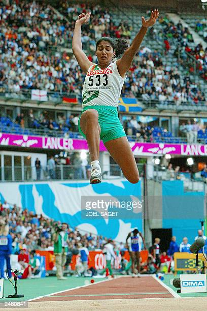 Anju Bobby George of India competes in the women's long jump final 30 August 2003 during the 9th IAAF World Athletics Championships at the Stade de...