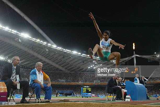 Anju Bobby George of India competes infront of the Olympic flame in the women's long jump qualifying round on August 25 2004 during the Athens 2004...