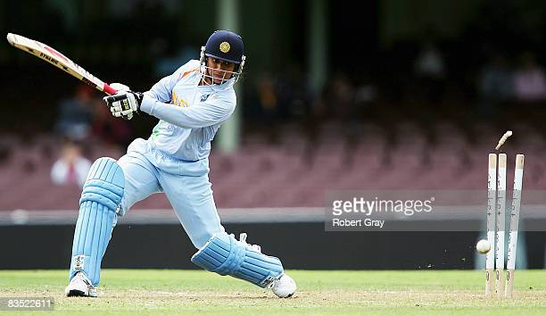 Anjun Chopra of India is bowled out by Kirsten Pike of Australia during the second women`s one day international match between the Australian...