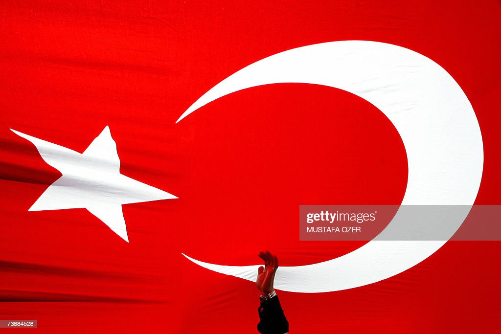 A demonstrator holds the national flag during a rally in support of secularism on Tandogan square in Ankara 14 April 2007 Hundreds of thousands of...