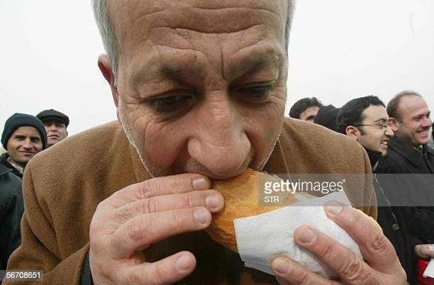 A Turkish man eats a chicken doner kebab prepared by Ankara Chicken Meat Distributers Platform in Ankara 31 January 2006 The platform distrubuted...