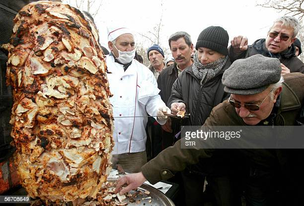 Turkish people wait in a queue for a chicken doner kebab prepared by Ankara Chicken Meat Distributers Platform in Ankara 31 January 2006 The platform...