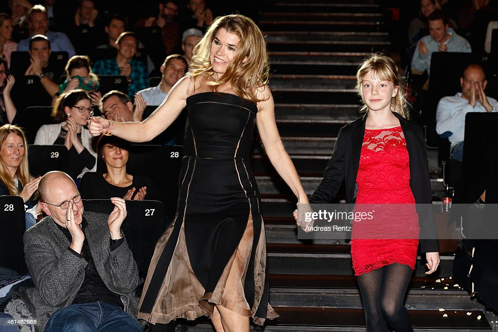 Anke Engelke and a child actress attend the premiere of the film 'Frau Mueller muss weg' at Cinedom on January 12, 2015 in Cologne, Germany.
