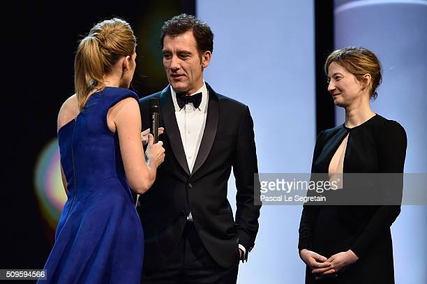 Anke Engelke and jury members Clive Owen and Alba Rohrwacher speak on stage during the opening ceremony of the 66th Berlinale International Film...