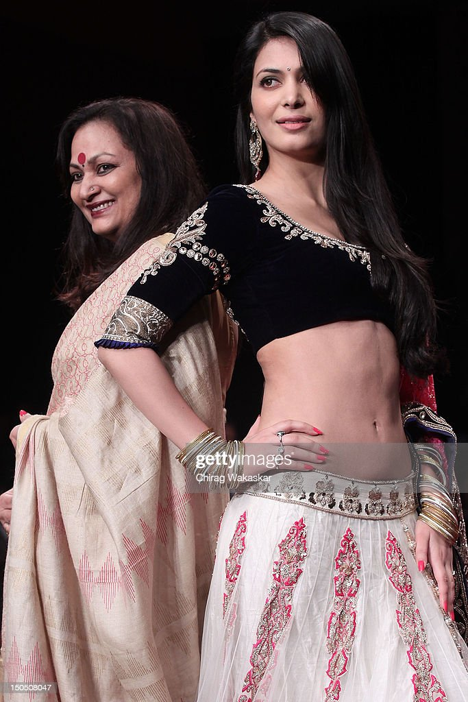 Ankita Shorey (R) & Neelam Shorey (L) walk the runway in a Gitanjali design at the India International Jewellery Week 2012 Day 1 at the Grand Hyatt on on August 19, 2012 in Mumbai, India.