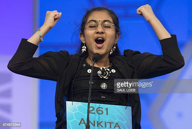 Ankita Vadiala of Manassas Virginia reacts to hearing her word during the semifinal round of the 88th Annual Scripps National Spelling Bee at...