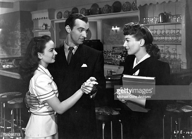 Ann Blyth plays Veda Pierce Zachary Scott is Monte Beragon and Joan Crawford is Mildred Pierce as they perform in a scene from the movie 'Mildred...