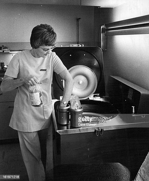 FEB 12 1972 FEB 15 1972 Ann Christensen a medical technologist and bloodbank supervisor places bag of blood in centrifuge to separate red cells from...