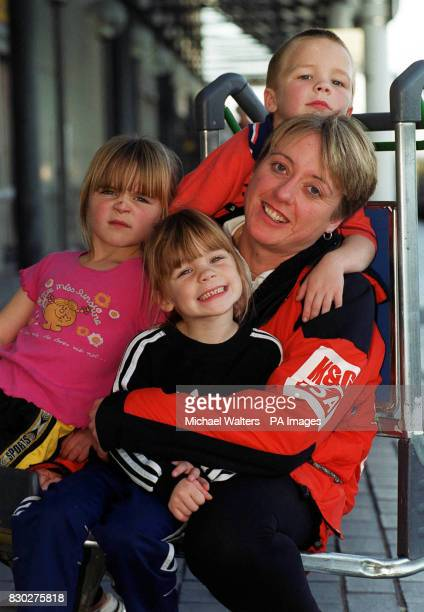 Ann Daniels from Yeovil with her 5 yearold triplets Joseph Luck and Rachel at Gatwick Airport before joining 4 other women to make history by...