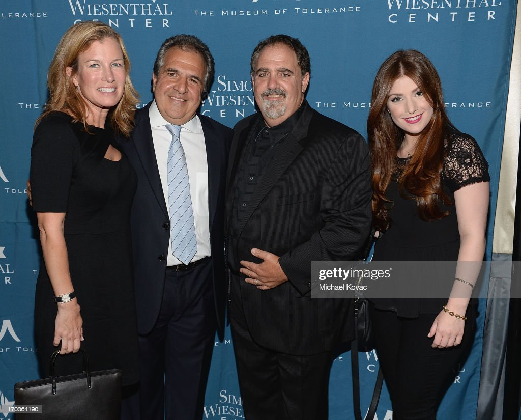 Ann Gianopulos, Chairman & Chief Executive Officer of Fox Filmed Entertainment Jim Gianopulos, producer Jon Landau, and Mimi Gianopulos arrive at the Simon Wiesenthal Center National Tribute Dinner at Regent Beverly Wilshire Hotel on June 11, 2013 in Beverly Hills, California.