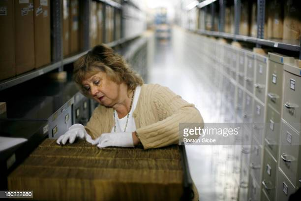 Ann Hartman of Corbis sorts though a drawer full of negatives in the Corbis vault within Iron Mountain's western Pennsylvania storage facility...