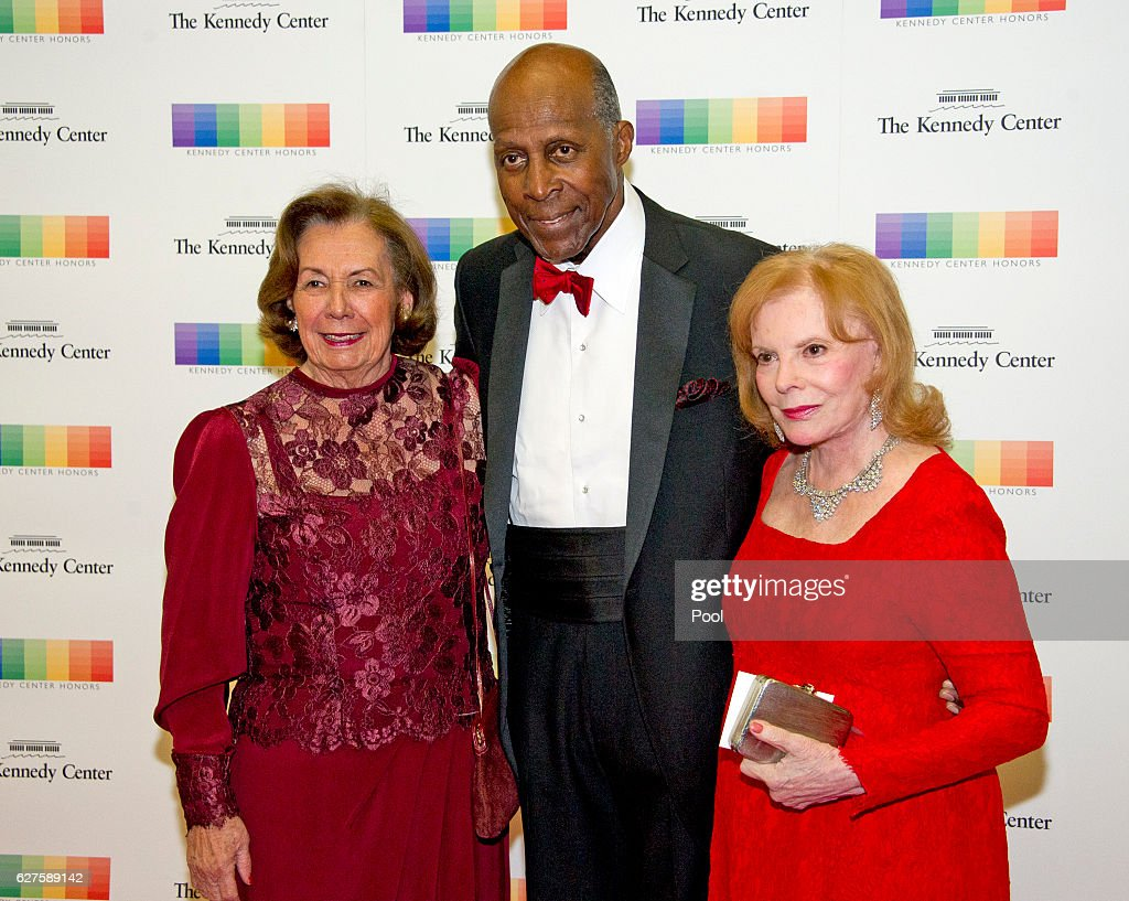 Ann Jordan, left, Vernon Jordan, center, and Buffy Cafritz, right, arrive for the formal Artist's Dinner honoring the recipients of the 39th Annual Kennedy Center Honors hosted by United States Secretary of State John F. Kerry at the U.S. Department of State on December 3, 2016 in Washington, D.C. The 2016 honorees are: Argentine pianist Martha Argerich; rock band the Eagles; screen and stage actor Al Pacino; gospel and blues singer Mavis Staples; and musician James Taylor.