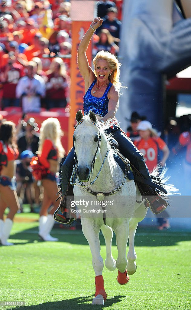 Ann Judge Wegener rides Thunder to lead the Denver Broncos onto the field before the game against the Washington Redskins at Sports Authority Field on October 27, 2013 in Denver, Colorado.