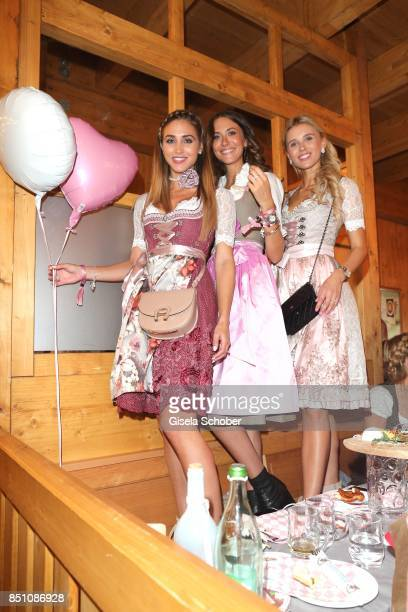 Ann Kathrin Broemmel fiance of Mario Goetze Laura Leshel and Scarlett Gartmann at the 'Madlwiesn' event during the Oktoberfest at Theresienwiese on...