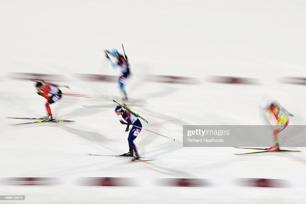 Ann Kristin Aafedt Flatland (front L) of Norway competes in the Women's 12.5 km Mass Start during day ten of the Sochi 2014 Winter Olympics at Laura Cross-country Ski & Biathlon Center on February 17, 2014 in Sochi, Russia.