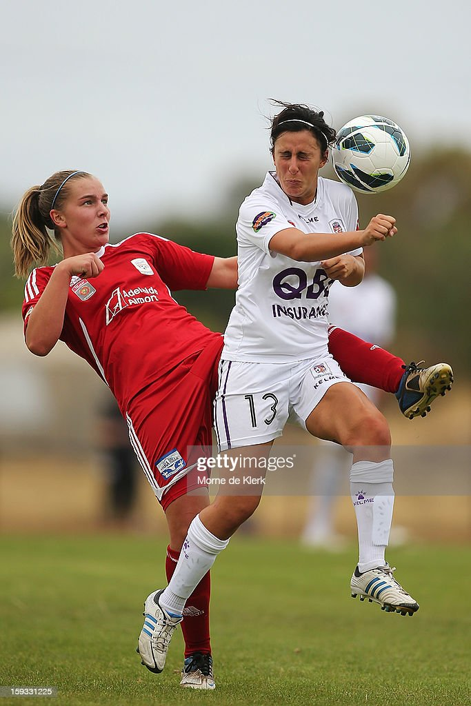 Ann Mayo of Adelaide and Elisa D'Ovidio of Perth compete during the round 12 W-League match between Adelaide United and the Perth Glory at Burton Park on January 12, 2013 in Adelaide, Australia.