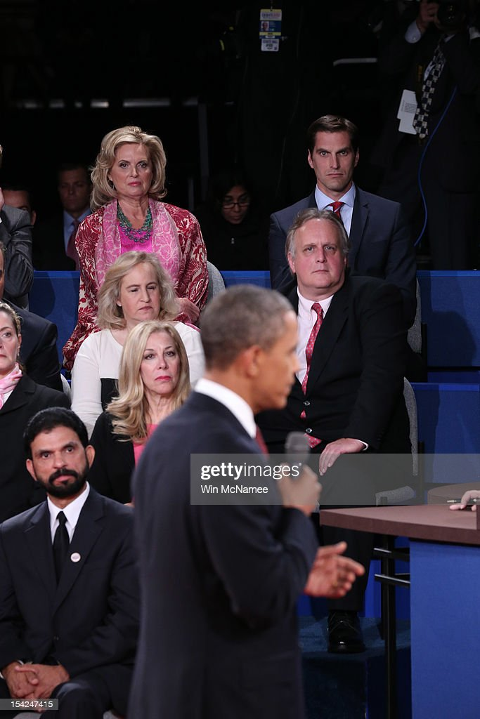 Ann Romney (L) and son Matt Romney (R) watch as U.S. President Barack Obama speaks during a town hall style debate with Republican presidential candidate Mitt Romney at Hofstra University October 16, 2012 in Hempstead, New York. During the second of three presidential debates, the candidates fielded questions from audience members on a wide variety of issues.