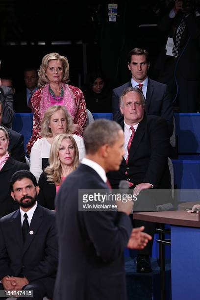 Ann Romney and son Matt Romney watch as US President Barack Obama speaks during a town hall style debate with Republican presidential candidate Mitt...