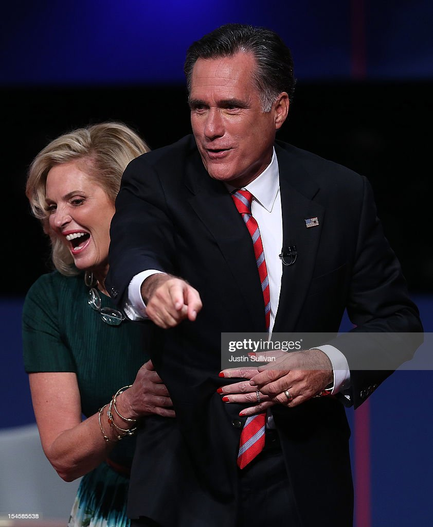 <a gi-track='captionPersonalityLinkClicked' href=/galleries/search?phrase=Ann+Romney&family=editorial&specificpeople=868004 ng-click='$event.stopPropagation()'>Ann Romney</a> (R) grabs her husband, Republican presidential candidate <a gi-track='captionPersonalityLinkClicked' href=/galleries/search?phrase=Mitt+Romney&family=editorial&specificpeople=207106 ng-click='$event.stopPropagation()'>Mitt Romney</a>, at the conclusion of a debate with U.S. President Barack Obama at the Keith C. and Elaine Johnson Wold Performing Arts Center at Lynn University on October 22, 2012 in Boca Raton, Florida. The focus for the final presidential debate before Election Day on November 6 is foreign policy.