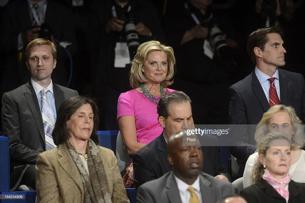 Ann Romney (C) sits with sons Ben Romney (L) and Matt Romney (R) before a town hall style debate at Hofstra University October 16, 2012 in Hempstead, New York. During the second of three presidential debates, the candidates fielded questions from audience members on a wide variety of issues.