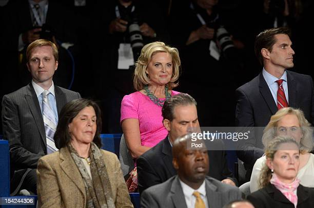Ann Romney sits with sons Ben Romney and Matt Romney before a town hall style debate at Hofstra University October 16 2012 in Hempstead New York...
