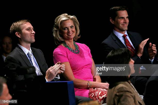 Ann Romney sits with sons Ben Romney and Matt Romney before the presidential town hall style debate at Hofstra University October 16 2012 in...