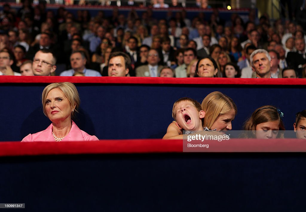 <a gi-track='captionPersonalityLinkClicked' href=/galleries/search?phrase=Ann+Romney&family=editorial&specificpeople=868004 ng-click='$event.stopPropagation()'>Ann Romney</a>, wife of Republican presidential candidate Mitt Romney, left, sits with <a gi-track='captionPersonalityLinkClicked' href=/galleries/search?phrase=Janna+Ryan&family=editorial&specificpeople=9632767 ng-click='$event.stopPropagation()'>Janna Ryan</a>, wife of Republican vice presidential candidate Paul Ryan, as she holds her yawning son Sam Ryan at the Republican National Convention (RNC) in Tampa, Florida, U.S., on Wednesday, Aug. 29, 2012. Representative Paul Ryan takes the stage tonight to address the RNC with a dual mission: to provide a spark, along with his big ideas about cutting the budget, to energize the party's base. Photographer: Scott Eells/Bloomberg via Getty Images