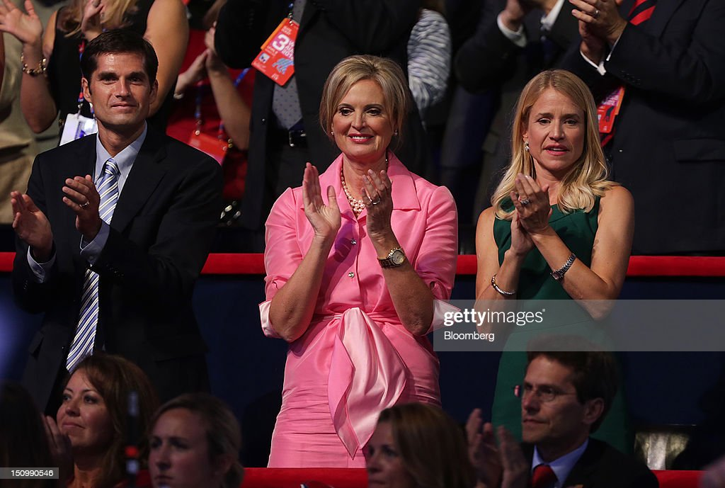 Ann Romney, wife of Republican presidential candidate Mitt Romney, center, son Matt Romney, left, and Janna Ryan, wife of Republican vice presidential candidate Paul Ryan, applaud at the Republican National Convention (RNC) in Tampa, Florida, U.S., on Wednesday, Aug. 29, 2012. Ryan takes the stage tonight to address the RNC with a dual mission: to provide a spark, along with his big ideas about cutting the budget, to energize the party's base. Photographer: Scott Eells/Bloomberg via Getty Images