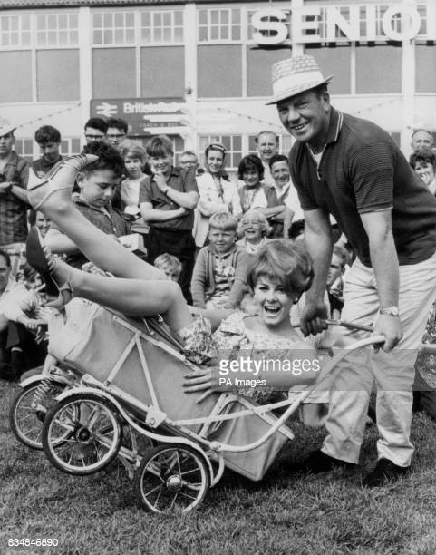 Ann Sidney who was Miss World goes for a pram ride pushed by Gerald Smith at Butlin's Holiday Camp in Bognor Regis