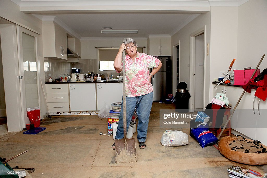 Ann Taylor of The Rocks, stands in her kitchen with a shovel after floodwaters inundate her home on March 7, 2012 on the outskirts of Wagga Wagga, Australia. 9000 evacuated residents are waiting for authorities to survey the city's levee to determine if it is safe to return home, after flood waters peaked at 10.6 metres - less than the 10.9 metre peak predicted. Residents on Monday were instructed to evacuate and the town was declared a disaster zone with authorities predicting floodwaters to reach a level that would likely break the levee, flood the cities central district, and cause the worst flooding in decades.