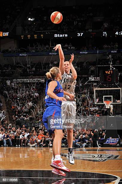 Ann Wauters of the San Antonio Silver Stars shoots against Kelly Schumacher of the Detroit Shock during Game Two of the WNBA Finals on October 3 2008...