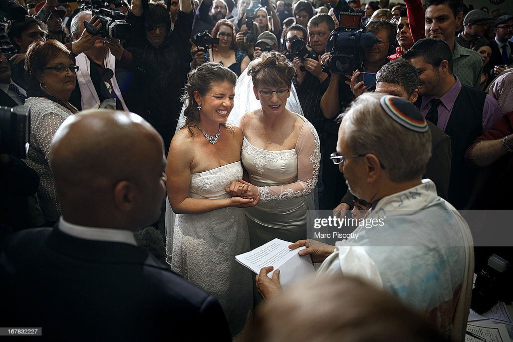 Anna (L) and Fran Simon, both of Denver, Colorado, are the first same-sex couple to be issued a Civil Union license at a midnight ceremony in the Denver Office of the Clerk and Recorder, at the Wellington E. Webb Municipal Office Building on May 1, 2013 in Denver, Co. Colorado is the eighth state to have civil unions or similar laws implemented, permitting unmarried couples, both gay and heterosexual, the ability to form civil unions and get similar rights to those of married couples.