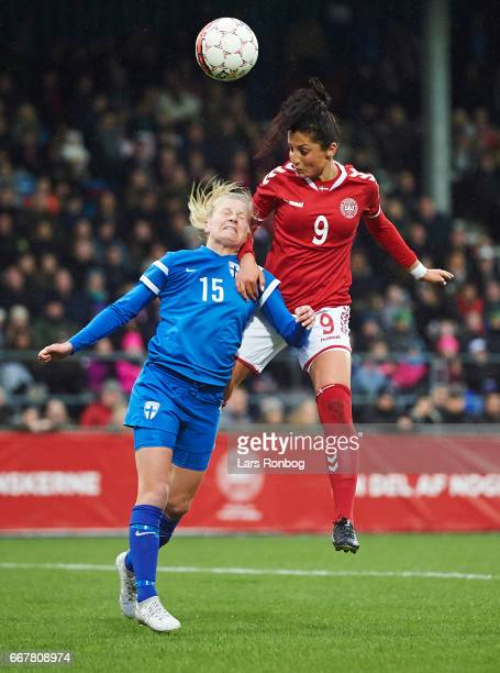 Anna Auvinen of Finland and Nadia Nadim of Denmark compete for the ball during the international friendly match between Denmark women and Finland...