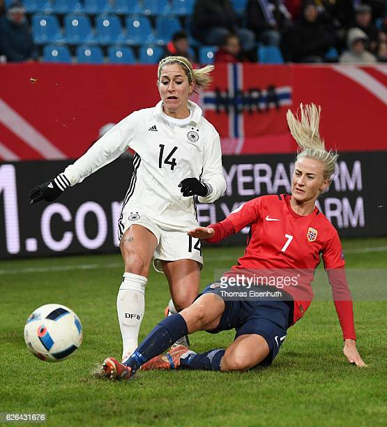Anna Blaesse of Germany is challenged by Anja Sonstevold of Norway during the women's international friendly match between Germany and Norway at...