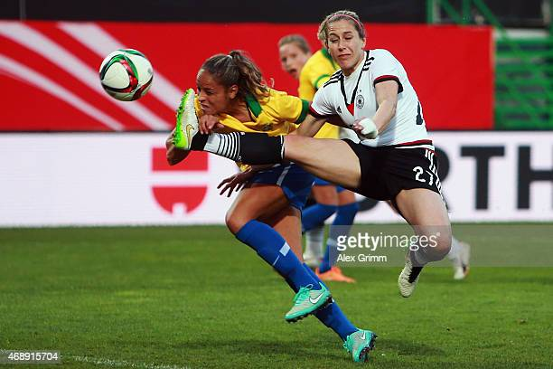 Anna Blaesse of Germany is challenged by Monica of Brazil during the Women's International Friendly match between Germany and Brazil at TrolliArena...