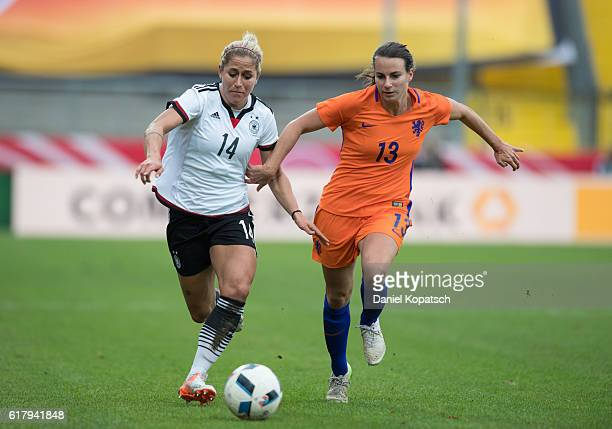 Anna Blaesse of Germany is challenged by Renate Jansen of the Netherlands during the Women's International Friendly match between Germany and the...