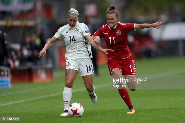 Anna Blasse of Germany and Katrine Veje of Denmark battle for possession during the UEFA Women's Euro 2017 Quarter Final match between Germany and...