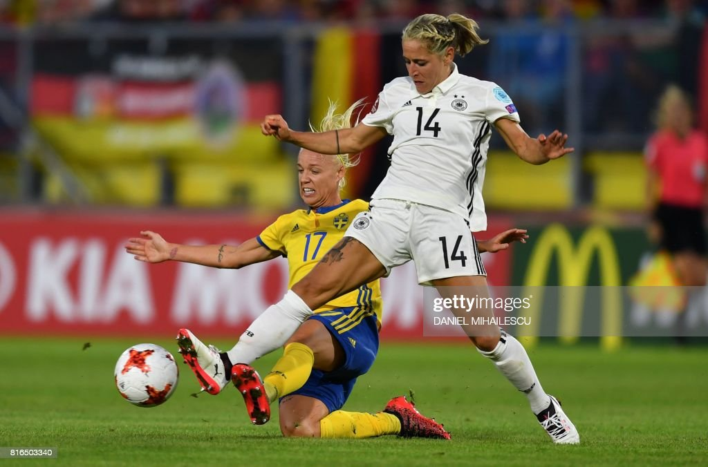 Anna Blasse (R) of Germany vies with Caroline Seger (L) of Sweden during the UEFA Womens Euro 2017 football tournament between Germany and Sweden at Rat Verlegh Stadium in Breda city on July 17, 2017. /
