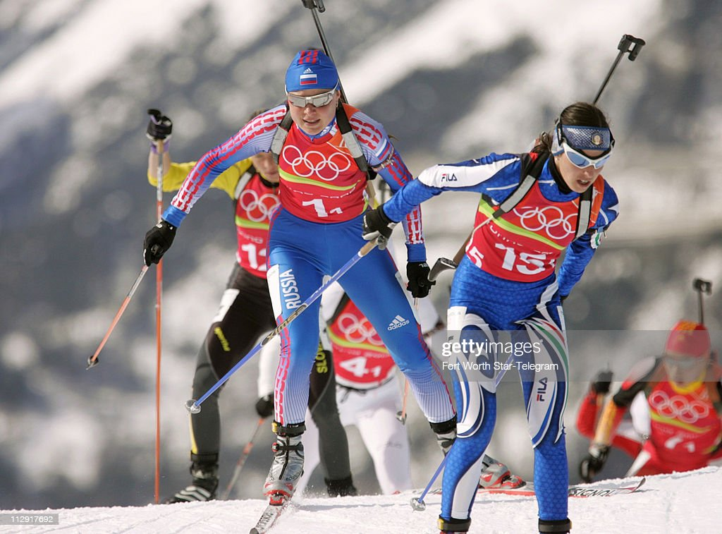 Anna Bogaliy of Russian Federation left and Michela Ponza of Italy race during the 2006 Winter Olympics Womens' Biathlon 4x6 KM Relay Thursday...