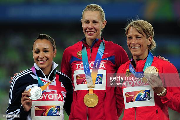 Anna Bogdanova of Russia poses with the gold medal and Jessica Ennis of Great Britain and Jennifer Oeser of Germany after the women's heptathlon...